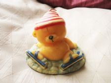 CUTE UNUSED VINTAGE WAX CANDLE IN SHAPE OF TEDDY BEAR ON SKATES WITH HAT SCARF